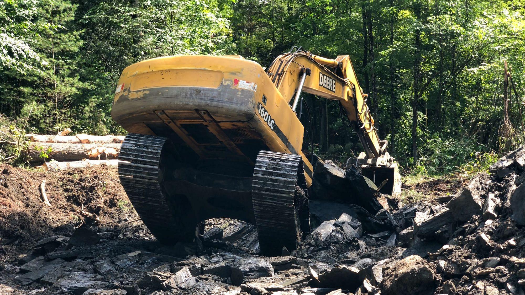 Excavator Removing Bedrock