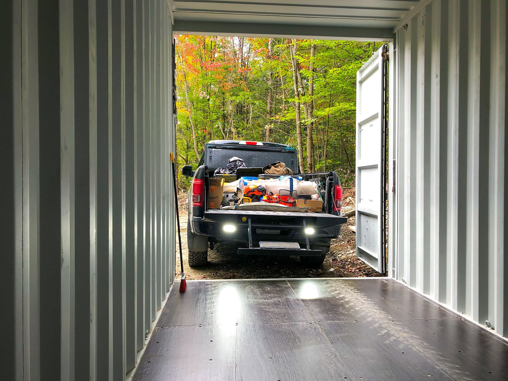 Unloading Truck Bed Shipping Container