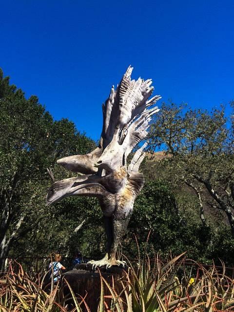 A wood sculpture in shape of a bird