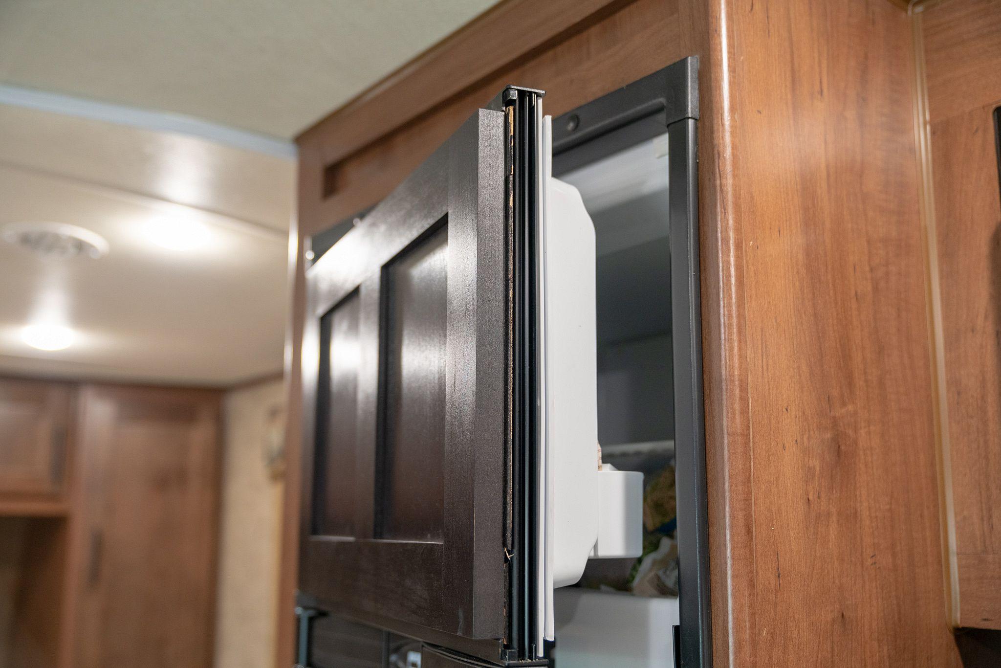 RV freezer door removal